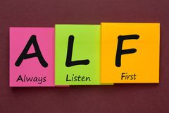 Always Listen First. ALF written on color notes. Advice for training Royalty Free Stock Photography