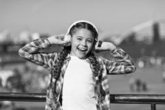Listen for free. Get music family subscription. Access to millions of songs. Enjoy music everywhere. Best music apps. That deserve a listen. Girl child listen stock photography