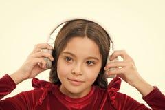 Listen for free new and upcoming popular songs right now. Little girl listen music wireless headphones. Online music stock photo