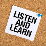 Listen And Learn. Reminder Note on Cork Bulletin Board Stock Image