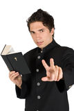 Listen me!Priest with holy bible Royalty Free Stock Images