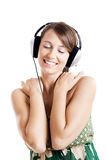 Listen music. Beautiful young woman listen music with headphones, isolated on white Royalty Free Stock Images