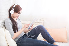 Listen music in digital tablet Royalty Free Stock Photography