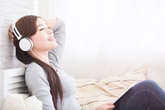 Listen music in digital tablet Stock Photography