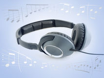 Listen Music. Music headphones over gradient blue background surrounded by music sheet notes Royalty Free Stock Photography