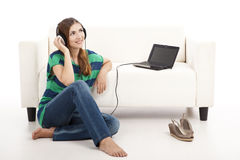 Listen music on a laptop Royalty Free Stock Photo
