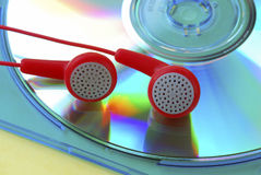Listen music from a MP3 CD with the earphone Royalty Free Stock Photo