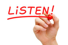 Listen Red Marker. Hand writing Listen with red marker on transparent wipe board Stock Image