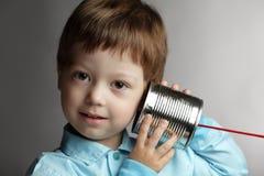 listen tin can telephone stock photos
