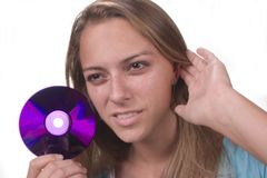 Listen to it. Teen with CD series Royalty Free Stock Photo