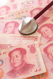 Listen to Chinese Money yuan by stethoscope, for f Stock Photography