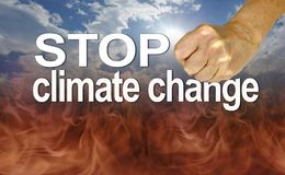 Listen to the Experts and Stop Climate Change. Warning to stop climate change with a fist coming down on the word CHANGE against a blue sun and sky background stock photos