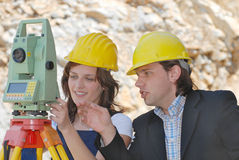 Listen to me. Boss and female worker measuring distance Royalty Free Stock Photography