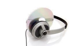 Listen to me. Stereo headphones and cd on white Royalty Free Stock Photo