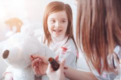Attentive child having nice talk with her doctor stock photography