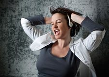 Listen to the music 1_2. Girl listening and dancing to supersoundmusic Royalty Free Stock Photos