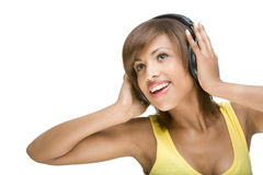 Listen to the music. Full isolated portrait of a beautiful african woman listen to the music Stock Photo