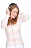 Listen to the music. Full isolated portrait of a beautiful caucasian woman listen to the music Royalty Free Stock Photo