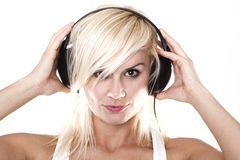 Listen to the music. Beautiful girl is listen to the music Royalty Free Stock Image