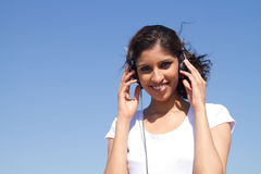 Listen to music. Young woman listen to music with headphones Royalty Free Stock Image