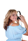 Listen to music. Woman listens music with headphones Royalty Free Stock Photography