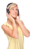 Listen to the music. Full isolated portrait of a beautiful woman listen to the music Stock Photos