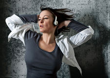 Listen to the music 2_2. Girl listening and dancing to supersoundmusic Royalty Free Stock Images