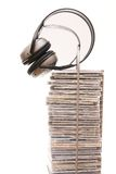 Listen to the music. Compact disc rack with headphones isolated on white Stock Images