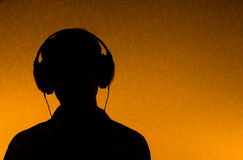 Listen to Music - man with earphones royalty free stock images