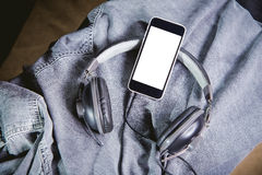 Listen to music, phone, shirt and headphones Stock Photos
