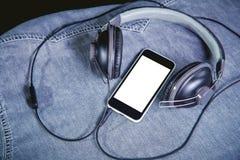 Listen to music, phone, shirt and headphones Royalty Free Stock Photo