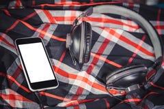 Listen to music, phone, shirt and headphones Stock Photo