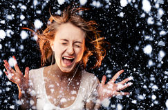 Listen to the Music on a snowfall background Royalty Free Stock Photos