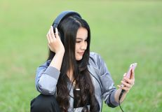 Listen to music. Young girls listen to music smartphones in relax Royalty Free Stock Photo