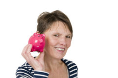 Listen to the piggy bank Royalty Free Stock Photography
