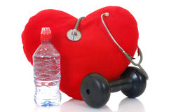 Listen to your heart. Heart with bottle and stethoscope isolated on white background Stock Photography