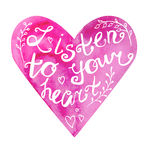 Listen to your heart lettering. Vector image of hand drawn pink watercolor heart with hand written phrase Listen to your heart. Motivation slogan on bright stock illustration