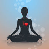 Listen to your heart. Lotus position Stock Photos