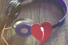 Listen to your heart. Love and music concept Stock Photos