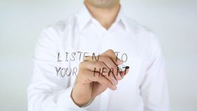 Listen To Your Heart, Man Writing on Glass stock photography
