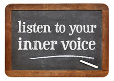 Listen to your inner voice. Advice - white chalk text on a vintage slate blackboard Stock Photography