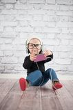 Listener. Cute baby girl with mp3 player Stock Photos
