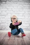 Listener. Cute baby girl with mp3 player Stock Images