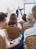 Listener during dull presentation Stock Photo