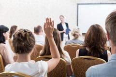 Listener raising hand to ask Royalty Free Stock Photo