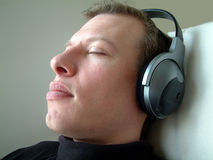 Listening. Man listening to music (headphones Stock Photos