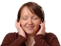 Listening. Woman listening to music, on white background stock photography