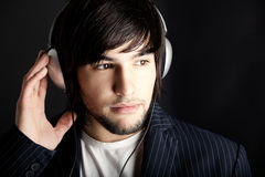 Listening. Young Man listening to music with headphones Stock Photos