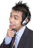 Listening Asian telemarketer Royalty Free Stock Images