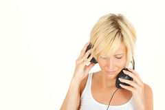 Listening blond music girl Royalty Free Stock Image